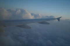 Airplane flying high in the sky Royalty Free Stock Photography
