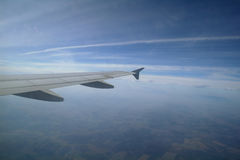 Airplane flying high in the  sky Royalty Free Stock Image