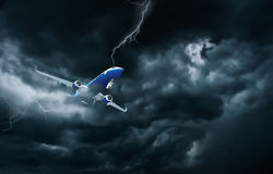 Airplane flying and landing in storm royalty free stock image