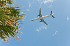 Airplane flying low Stock Images
