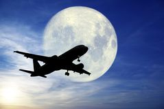 Airplane flying in the night. An airplane flying in the night Stock Image