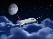 Airplane flying in the night sky. Dream flight concept - Passenger airplane flying above night cloudy sky Stock Photo