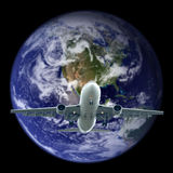 airplane flying out the earth.Elements of this image furnished b Royalty Free Stock Photo