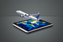 Airplane flying out tablet Royalty Free Stock Photography