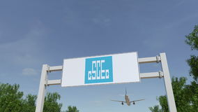 Airplane flying over advertising billboard with China State Construction Engineering Corporation logo.Editorial 3D Royalty Free Stock Photography