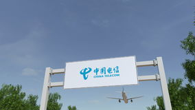 Airplane flying over advertising billboard with China Telecom logo. Editorial 3D rendering 4K clip stock footage