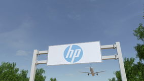 Airplane flying over advertising billboard with HP Inc. logo. Editorial 3D rendering 4K clip