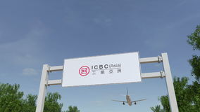 Airplane flying over advertising billboard with Industrial and Commercial Bank of China ICBC logo. Editorial 3D Stock Photos
