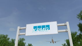 Airplane flying over advertising billboard with KPMG logo. Editorial 3D rendering Royalty Free Stock Images