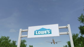 Airplane flying over advertising billboard with Lowe`s logo. Editorial 3D rendering 4K clip stock illustration