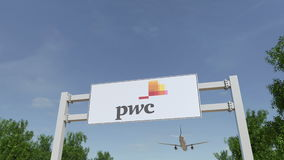 Airplane flying over advertising billboard with PricewaterhouseCoopers PwC logo. Editorial 3D rendering Royalty Free Stock Image
