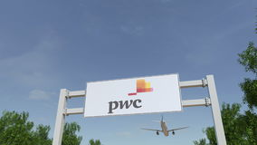 Airplane flying over advertising billboard with PricewaterhouseCoopers PwC logo. Editorial 3D rendering 4K clip stock illustration