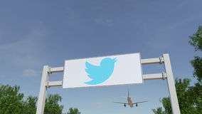 Airplane flying over advertising billboard with Twitter, Inc. logo. Editorial 3D rendering. Airplane flying over advertising billboard with Twitter, Inc. logo Royalty Free Stock Images