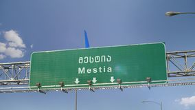 Airplane Landing Mestia. Airplane flying over airport signboard stock video footage