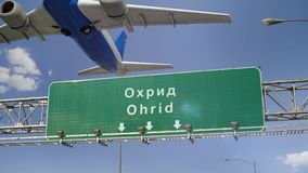 Airplane Take off Ohrid. Airplane flying over airport signboard stock video footage
