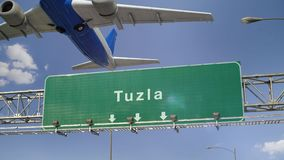 Airplane Take off Tuzla. Airplane flying over airport signboard stock footage