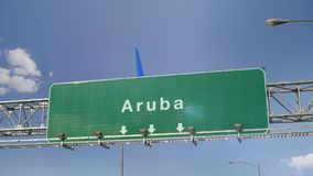 Airplane Landing Aruba. Airplane flying over airport signboard stock video footage