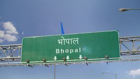 Airplane Landing Bhopal. Airplane flying over airport signboard stock footage