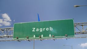 Airplane Landing Zagreb. Airplane flying over airport signboard stock video footage