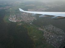 Airplane flying over Bayern, Germany. Approaching international airport in Munich stock photography
