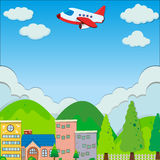 Airplane flying over buildings in suburb Royalty Free Stock Photography
