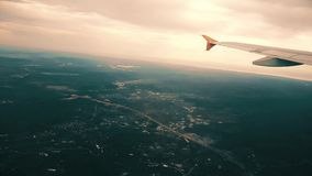 Airplane flying over the city, view from the window stock video footage