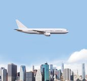 Airplane flying over city Royalty Free Stock Photo