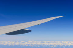 Airplane flying over clouds Stock Photos