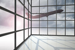 Airplane flying over clouds past window Royalty Free Stock Images