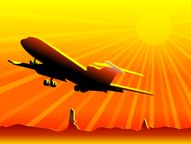 Airplane flying over desert Royalty Free Stock Photography