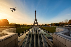 Airplane flying over Eiffel Tower in morning, Paris, France. Stock Images