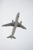 Airplane flying over head Stock Images