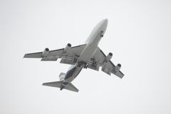 Airplane flying over head Stock Photos