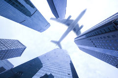 Airplane flying over high buildings,Shanghai business center Royalty Free Stock Photo