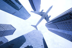 Airplane flying over high buildings,Shanghai business center Royalty Free Stock Photography