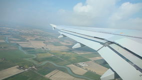Airplane flying over land stock footage