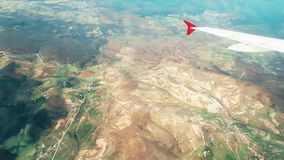 Airplane flying over the mainland, view from the window stock video footage