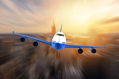 Airplane flying over a moden metropoly Stock Photo
