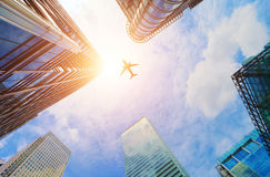 Airplane flying over modern business skyscrapers. Transport, travel. Airplane flying over modern business skyscrapers, high-rise buildings. Transport royalty free stock photos