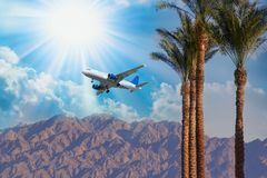 Airplane flying over the mountains. Travel concept stock photography