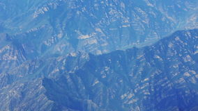 Airplane flying over mountains stock video footage