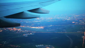 Airplane flying over night Moscow stock video footage