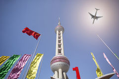 Airplane flying over Oriental Pearl Tower Stock Image