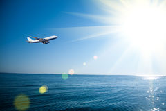 Airplane flying over the sea Royalty Free Stock Image