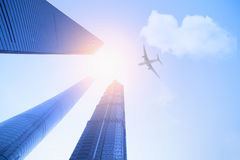 Airplane flying over Shanghai top 3 building Stock Photos