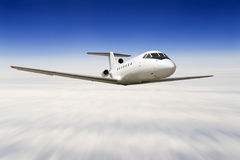 Airplane flying over a sky. (zoom blur Royalty Free Stock Photo