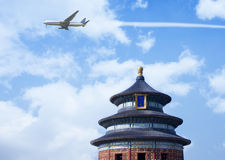 Airplane flying over Temple of Heaven Stock Images