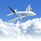 Airplane Flying Over The Clouds Side Front View Stock Photo