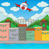 Airplane flying over the town Royalty Free Stock Photos