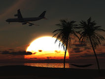Airplane flying over tropical beach at sunset. Royalty Free Stock Photography